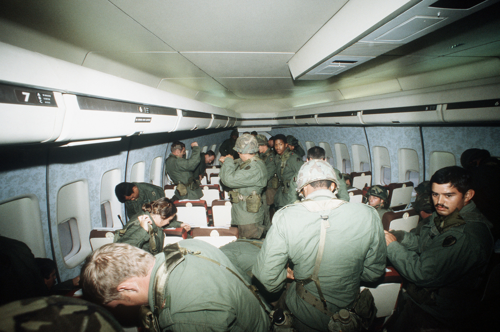 U. S. Army troops from the 25th Infantry Division gather their gear together as preparation are made to disembark their B-747 aircraft. The men are participating in Exercise Team Spirit '82