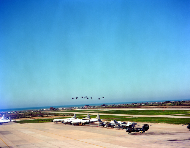 Spanish helicopters fly in formation over the airfield