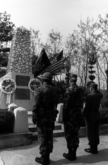 A commemorative ceremony is held at the Task Force Smith Memorial in honor of the men who fell near this spot on July 5, 1950. From left to right are Lieutenant Colonel Tilden Ried, Commander, 1ST Battalion, 21 Infantry; Major General Alexander M. Weyand, Commander, 25th Infantry Division, and General Park Noh Young of the South Korean army