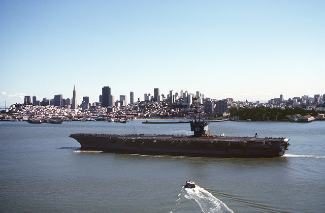 A port view of the nuclear-powered aircraft carrier USS ENTERPRISE (CVN-65) steaming past San Francisco