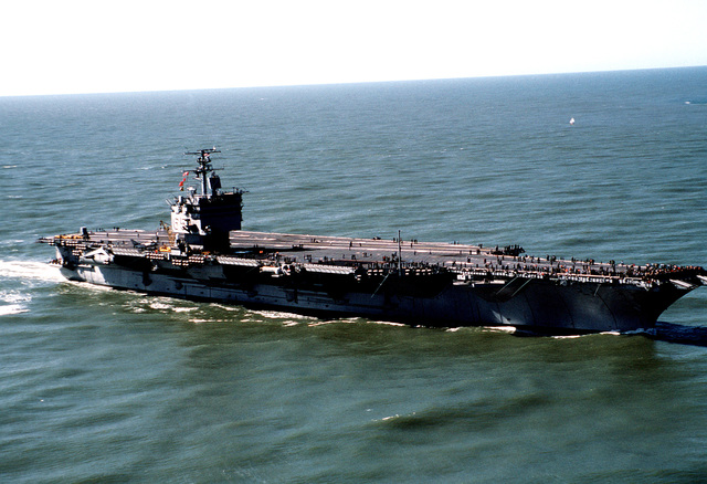 A starboard view of the nuclear-powered aircraft carrier USS ENTERPRISE (CVN-65) approaching the entrance to the San Francisco Bay