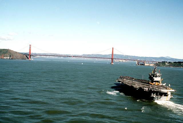 A stern view of the nuclear-powered aircraft carrier USS ENTERPRISE (CVN-65) approaching the Golden Gate Bridge and the entrance to the San Francisco Bay