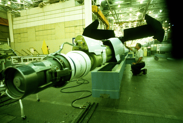 Jerry Preston, a senior supervisor for McDonnell Douglas, makes a last minute check on a boom assembly before it is transferred for installation on a KC-10 Extender aircraft