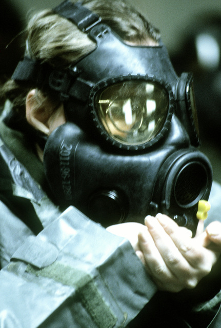 SGT Claire O'Neill from the 459th Civil Engineering Flight clears her field protective mask during Exercise Prime Beef '82