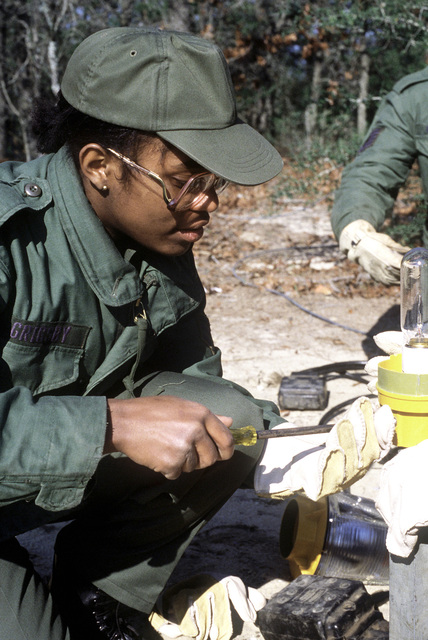 SRA Grigsby from the 459th Civil Engineering Flight assembles temporary airfield lighting during Exercise Prime Beef '82