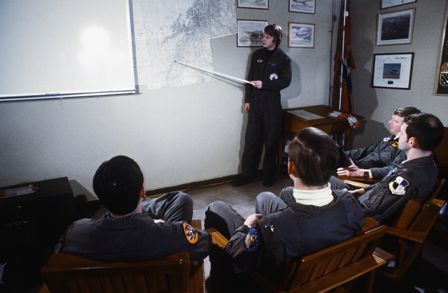 First LT. Geir Haugland, a Norwegian F-16A Fighting Falcon aircraft pilot with the 331st Squadron, briefs four U.S. Air Force pilots on exercise Alloy Express
