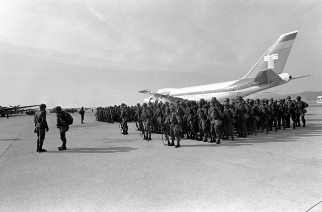 Soldiers from the 1ST Bn., 14th Inf., 2nd Bde., 25th Inf. Div., stand in formation after arriving aboard a chartered Transamerica aircraft to participate in TEAM SPIRIT '82