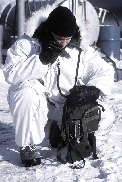 An officer from the 18th Fighter Squadron operates a UHF air-to-ground radio to contact inbound A-10 Thunderbolt II aircraft. The A-10's are participating in exercise Cool Snow Hog '82-1