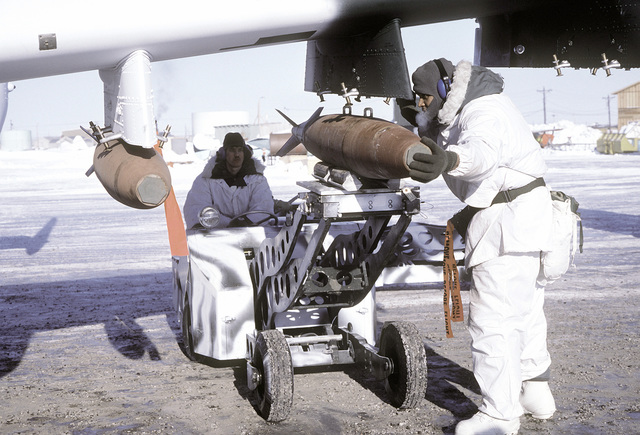 Ground crewmen load a Mark 82 bomb aboard an A-10 Thunderbolt II aircraft during exercise Cool Snow Hog '82-1