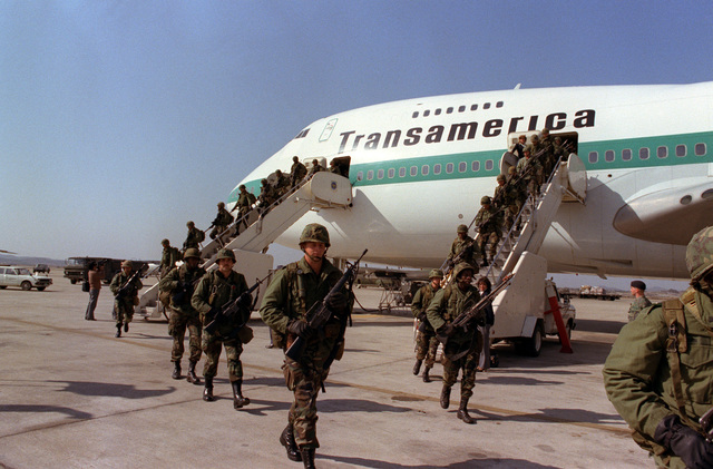 Members of the 1ST Battalion, 35th Infantry, 25th Infantry Division, arrive to participate in the joint South Korean/US training Exercise TEAM SPIRIT '82