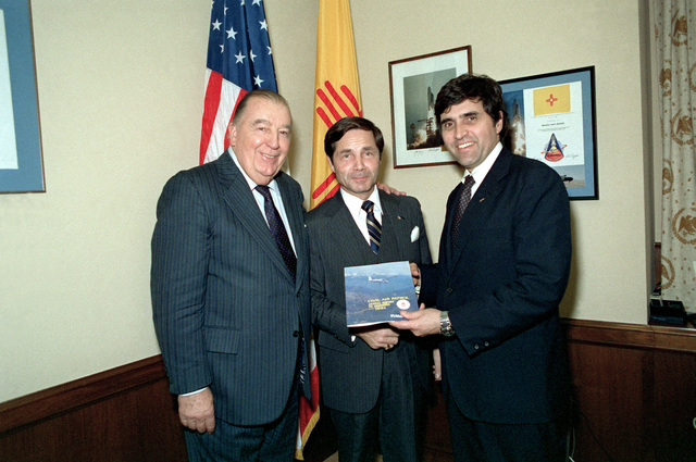 Sen. Harrison Schmitt, D-N.M., and Sen. Jennings Randolph, R-W.Va., are presented the 1981 Civil Air Patrol yearbook by Assistant Secretary of the Air Force George P.A. Forschler