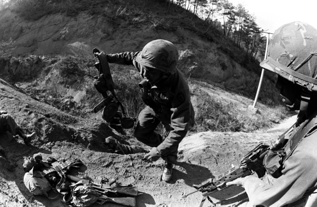 "Members of Company C, 1ST Battalion, 35th Infantry, 25th Infantry Division, capture an ""enemy"" position during the joint South Korean/US training Exercise TEAM SPIRIT '82"