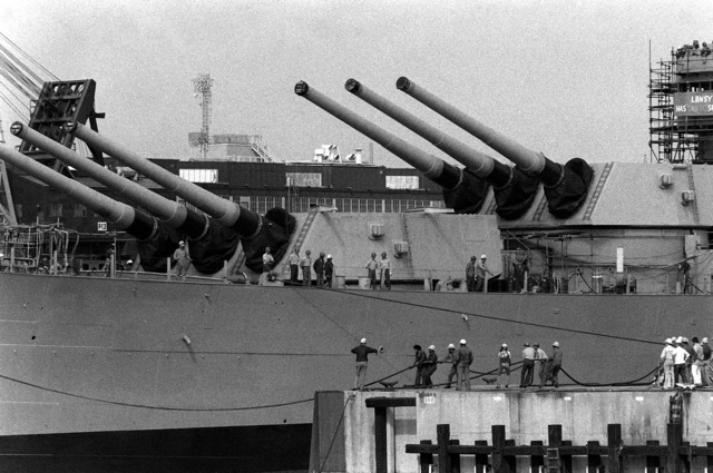 """A view of """"A"""" and """"B"""" turrets aboard the battleship NEW JERSEY (BB-62) as the ship is floated out of drydock here. It is being refitted for active service after 12 years in storage"""
