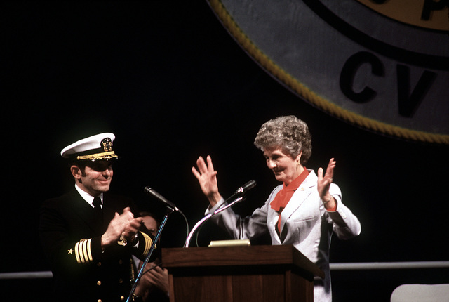 CAPT Richard L. Martin, commanding officer, applauds Molly Snead, ship's sponsor, during the commissioning ceremony for the nuclear-powered aircraft carrier USS CARL VINSON