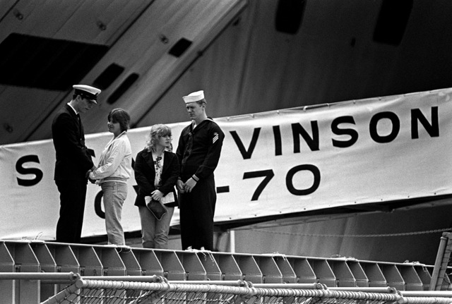 Families of the crewmen of the nuclear-powered aircraft carrier USS CARL VINSON (CVN-70) board the ship for a dependents cruise at the conclusion of the commissioning ceremony
