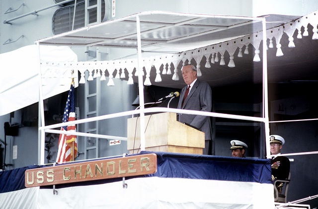 Leonard Erb, president, Ingalls Shipbuilding Division, speaks to the crew and honored guests during the commissioning ceremony for the guided missile destroyer USS CHANDLER (DDG-996)