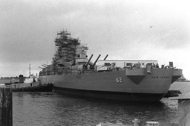 Port quarter view of the battleship NEW JERSEY (BB-62) just after it cleared a drydock here. The ship is being refitted for active service after 12 years of mothball storage