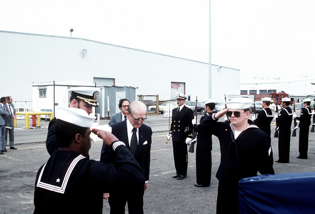 Sen. John C. Stennis, R-Mississippi, prepares to walk up the gangplank to board the guided missile destroyer USS CHANDLER (DDG-996) led by CDR Henry W. Strickland, commanding officer. The senator is one of the scheduled speakers for the commissioning ceremony of the CHANDLER