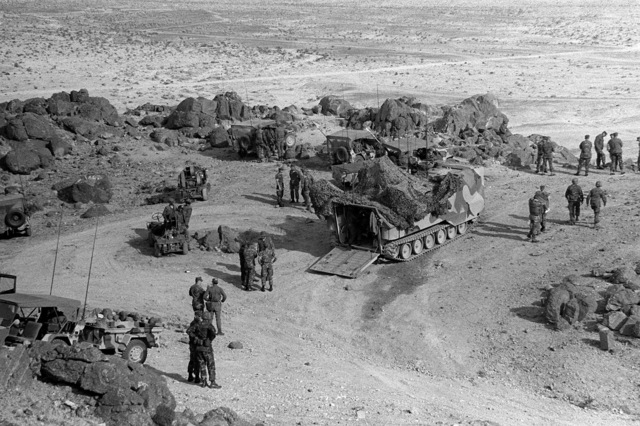 Bravo Command of the 3rd Battalion, 8th Marine Regiment, prepares for a live fire exercise during Operation CAX 4-81. In the center is a parked LVTP-7 tracked landing vehicle