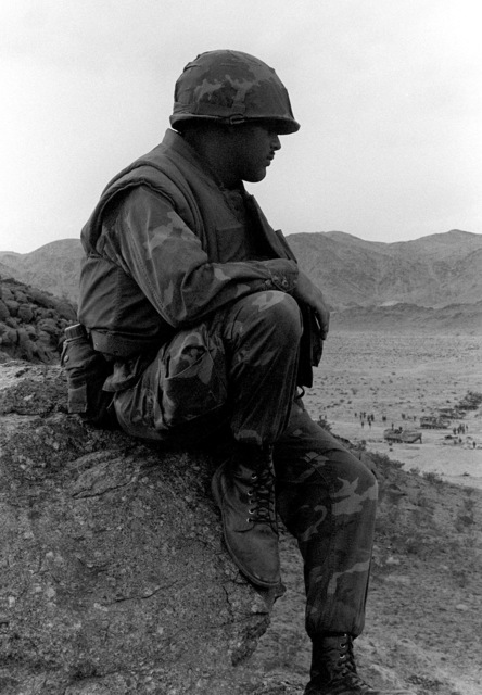 SGT Alier, 2nd Marine Division, PHOTO, waits for the Tank Company from the 8th Marine Regiment to move out for a live fire exercise during Operation CAX 4-81