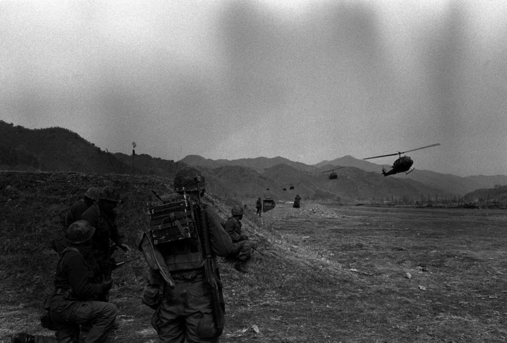 Infantry troops of the 1ST Bn., 21st Inf., 25th Inf. Div., hit the mock-up North Korean compound in the Korean Army Special Forces Training Area during an air-mobile assault using UH-1 Iroquois helicopters. The soldiers are participating in the joint Korea/U.S. training exercise Team Spirit '82