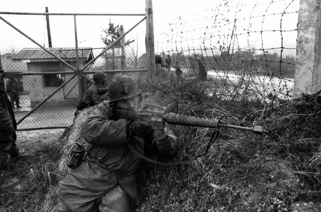 "Second LT. James Robbins, platoon leader, 3rd Plt., Co. B, 1ST Bn., 21st Inf., 25th Inf. Div., fires toward advancing ""enemy"" troops during the joint South Korean/U.S. training exercise Team Spirit '82"