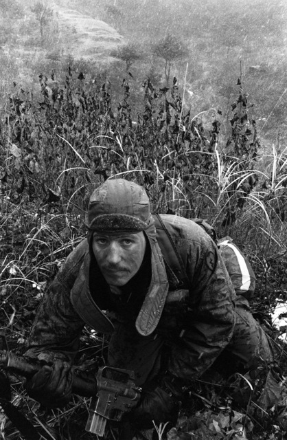 Sergeant Ben Baker of Company A, 1ST Battalion, 21st Infantry, 25th Infantry Division, climbs Hill 350 during the joint South Korean/US training Exercise TEAM SPIRIT '82