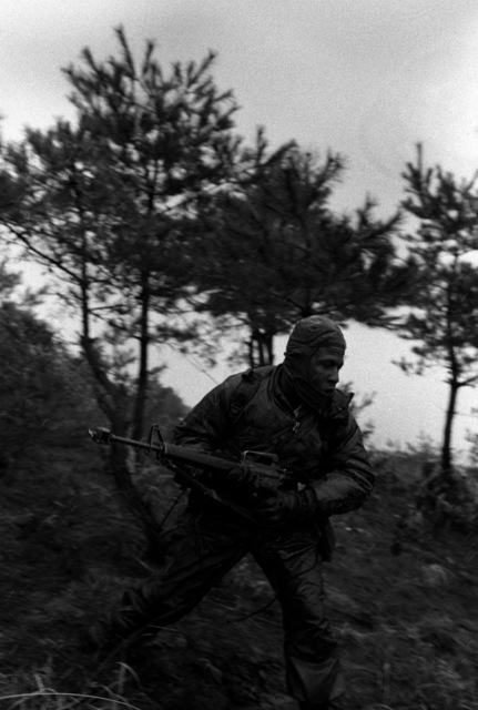 SSGT Steven Larson of Co. A, 1ST Bn., 21st Inf., 25th Inf. Div., on Hill 350 during the joint Korea/U.S. training exercise Team Spirit '82