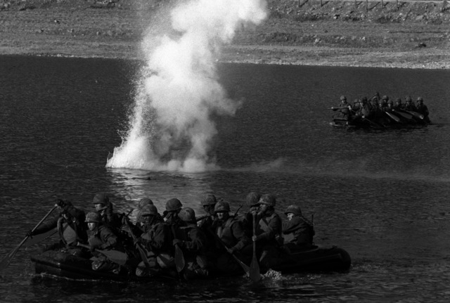 Infantry troops of the 1ST Bn., 21st Inf., 25th Inf. Div., cross the 400-yard wide Bung Han Gang River in rubber rafts during the joint Korea/U.S. training exercise Team Spirit '82
