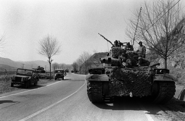 M-47 heavy tanks of the 2nd South Korean Army Tank Battalion move toward the combat outpost line in support of the 2nd Brigade, 25th Infantry Division, during the joint South Korea/U.S. training exercise Team Spirit '82