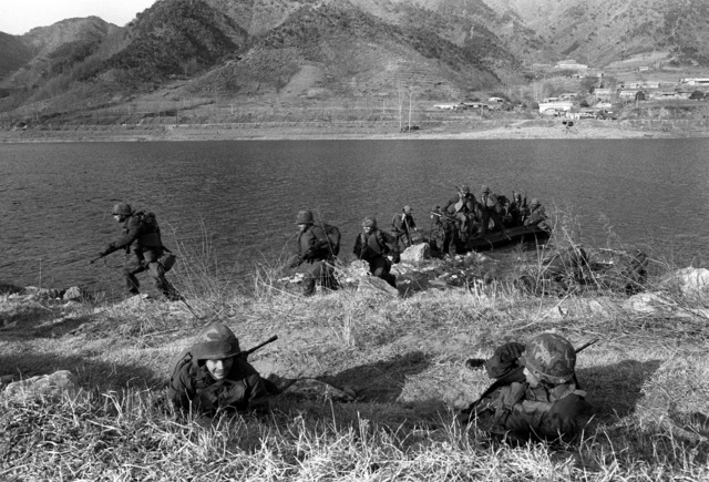 Members of the 1ST Battalion, 21st Infantry, 25th Infantry Division, prepare to cross the Bug Han Gang River during the joint South Korean/US training Exercise TEAM SPIRIT '82