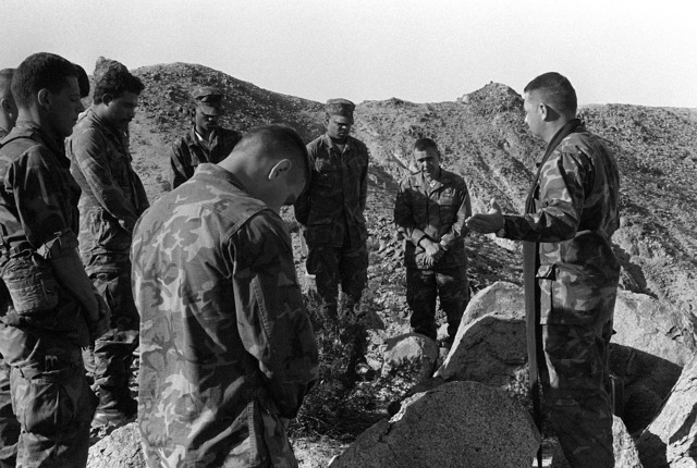 The chaplain of 3rd Battalion, 8th Marine Regiment, conducts mass in the field during Operation CAX 4-81