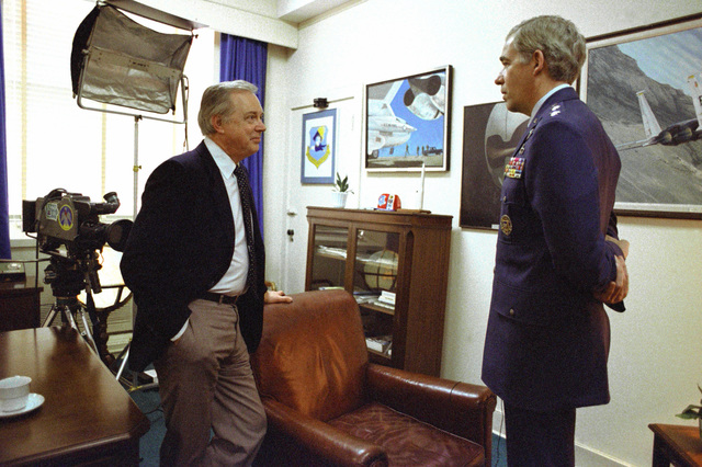 ABC television news commentator, Hugh Downs, has an informal discussion with MAJ. GEN. John T. Chain at the Pentagon