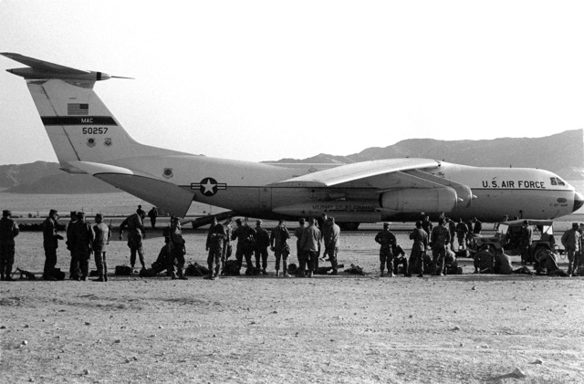 Men from the 2nd Marine Division line up to board a Military Airlift Command Air Force C-141B Starlifter aircraft for the trip to Cherry Point, North Carolina, at the completion of Operation CAX 4-81
