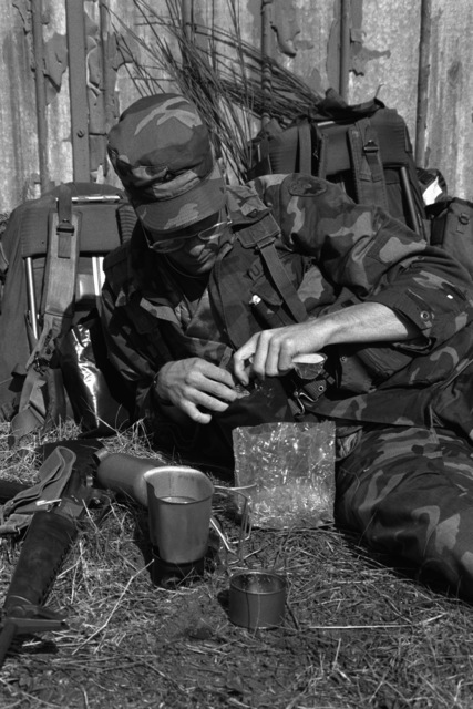 PFC Daniel Swain, a medic with the 9th Infantry Scout Company, heats some water to prepare a meal of hot field rations after returning from a three-day patrol