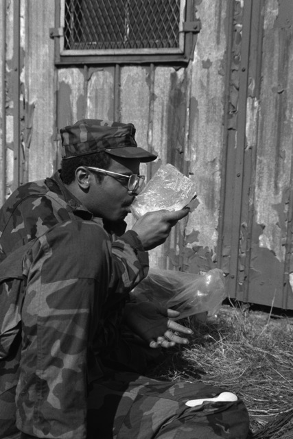 SPC5 David Jones, a medic with the 9th Infantry Scout Company, dines on a meal of hot field rations after returning from a three-day patrol