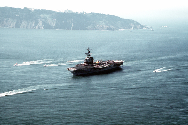 A port view of the aircraft carrier USS CORAL SEA (CV-43) underway. The carrier is returning to its home port of Naval Air Station, Alameda, California, after a Western Pacific (WESTPAC) deployment