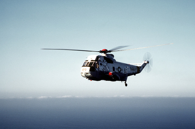 An air-to-air left side view of an SH-3D Sea King helicopter from Helicopter Combat Support Squadron 1 (HC-1), Detachment 3