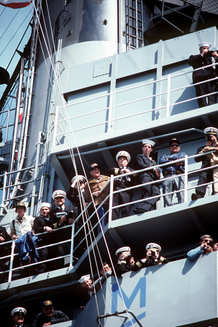 Crewmen aboard the aircraft carrier USS CORAL SEA (CV-43) man the rails as the ship returns to its home port, Naval Air Station, Alameda, California, after a Western Pacific (WESTPAC) deployment