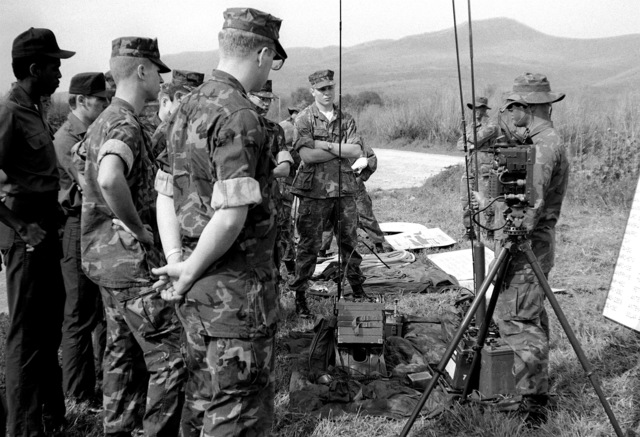 Communications equipment is explained to Marines from the Naval Reserve Officers Training Corps, Duke University, by a member of the 1ST Reconnaissance Battalion