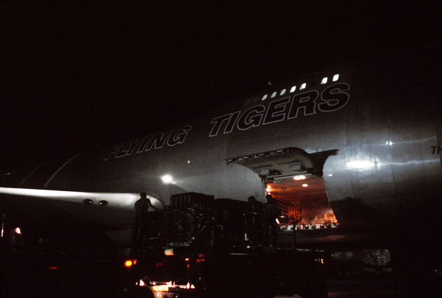 Cargo is loaded aboard a 747 Flying Tiger aircraft at night during exercise Ocean Venture '82