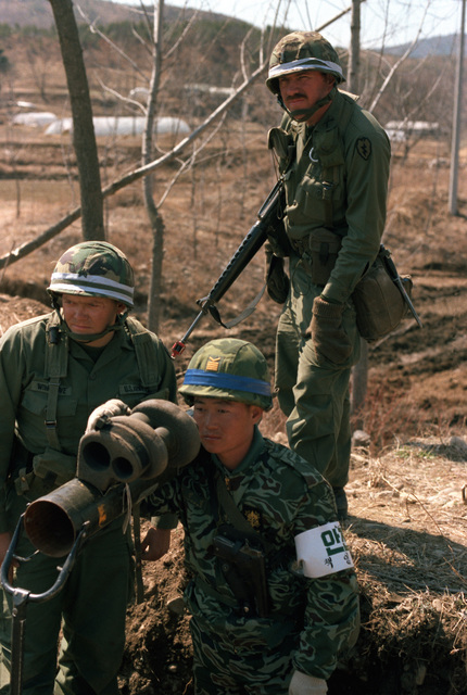 Members of the 25th Infantry Division from Schofield Barracks, Hawaii, and a member of the 2nd Republic of Korea Tank Battalion pinpoint the location of Orange Forces using the sight mechanism on an M-47 Dragon anti-tank weapon during the joint Republic of Korea/U.S. training Exercise Team Spirit '82