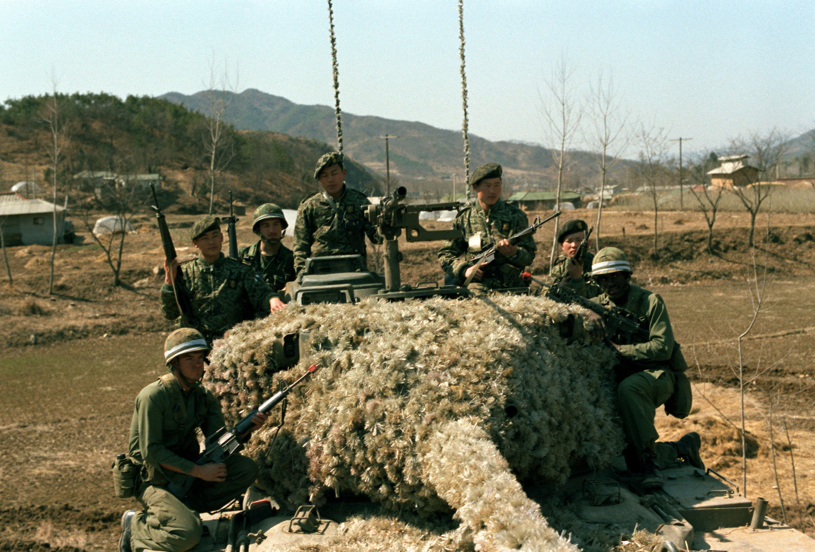 Members of the 25th Infantry Division from Schofield Barracks, Hawaii, and members of the 2nd Republic of Korea Army Tank Battalion, stand by with an M-47 tank to defend against aggressor action from the Orange Forces. The U.S. and Korean soldiers are acting as members of the Blue Forces during the training exercise Team Spirit '82