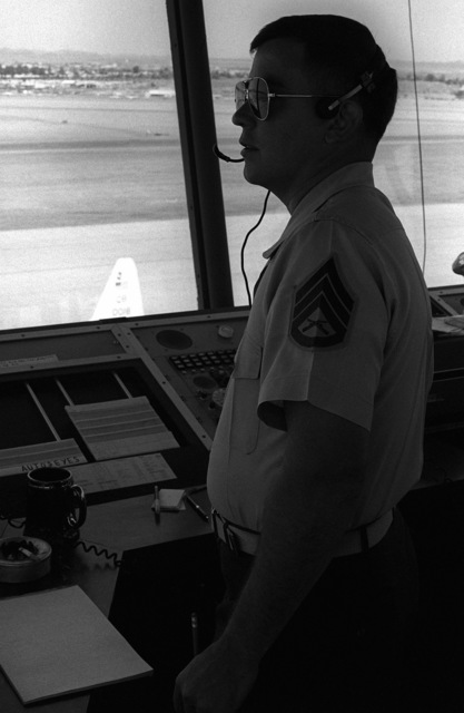 SSGT James Chitester, crew supervisor, monitors the runways and air traffic from the control tower