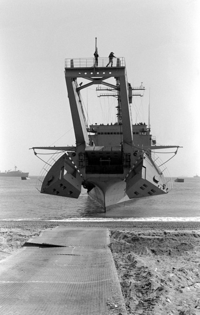 A bow view of a tank landing ship at Tok Sok Ri Beach during exercise Team Spirit '82. Note the open bulwarks for the lowering of the bow ramp
