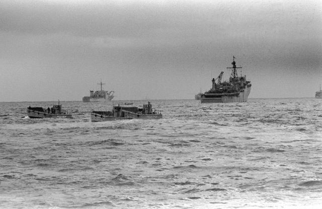 Landing craft approach Tok Sok Ri Beach while the dock landing ship USS MONTICELLO (LSD-35) and a tank landing ship are anchored off shore during exercise Team Spirit '82
