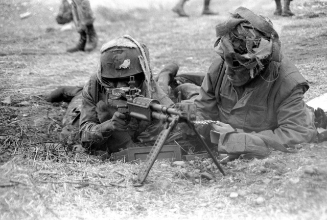 Marines fire rounds from an M-60 machine gun during exercise Team Spirit '82
