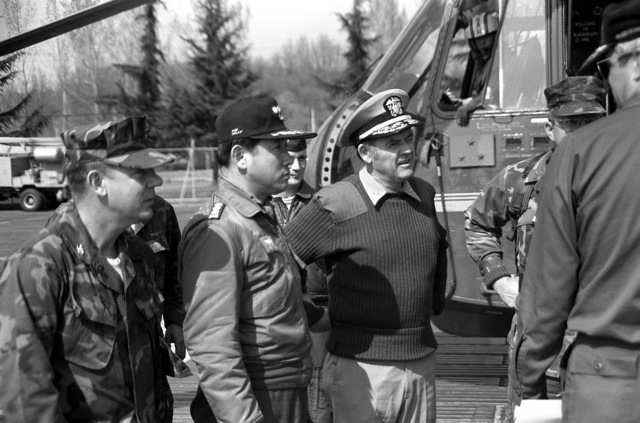 RADM George B. Schick Jr., commander, Amphibious Group One/Task Force '76, discusses the proceedings of exercise Team Spirit '82 with a U.S. Marine officer and a Korean officer
