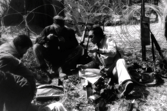 U.S. Marines and South Korean newsmen dine on survival rations during exercise Team Spirit '82