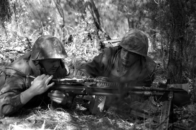 U.S. Marines fire rounds from an M-60 machine gun during exercise Team Spirit '82